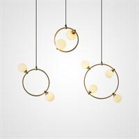 Подвесные светильники со стеклянными круглыми плафонами в кольцевом каркасе